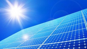 solar-panels-under-blue-sky-and-sun-flare